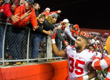 Chris Worley greets OSU fans after a win.