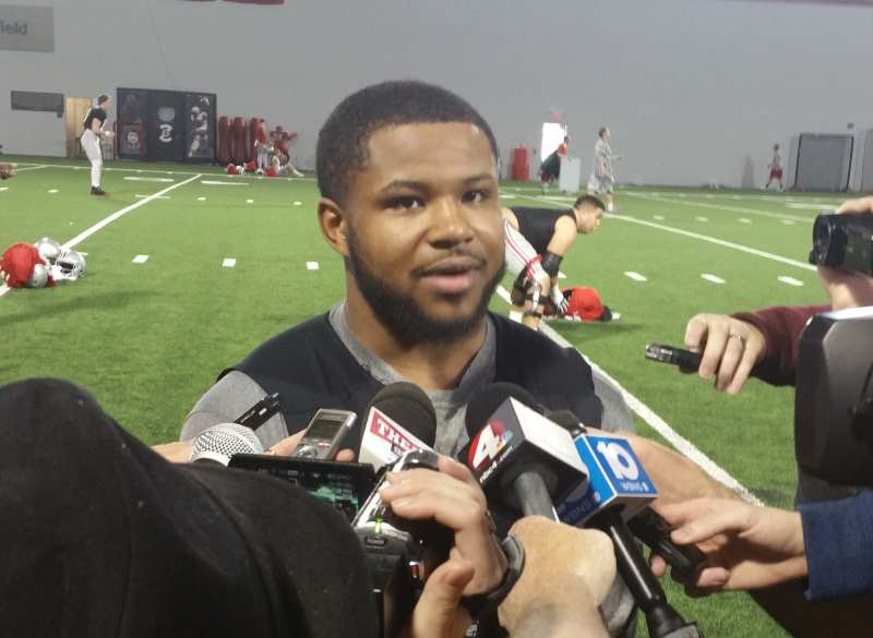 Mike Weber speaks with reporters following practice.
