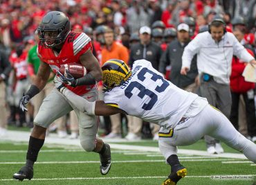 Ohio State football Ohio State Buckeyes running back Mike Weber breaks a tackle from Michigan Wolverines defensive end Taco Charlton.