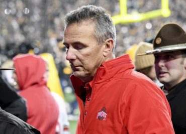 A dejected Urban Meyer leaves the field after the Buckeyes were ground into the dirt by Iowa.
