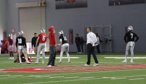 Urban Meyer watches Joe Burrow throwing
