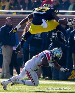 048 Devin Funchess hurdles Doran Grant Ohio State Michigan 2013